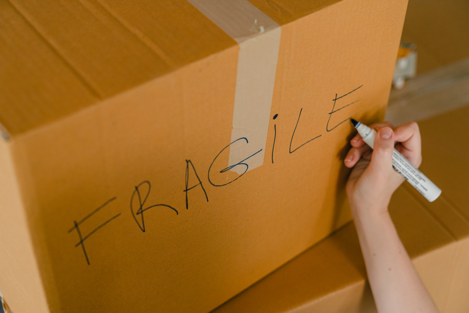 """A package with the  word """"fragile"""" written on it"""
